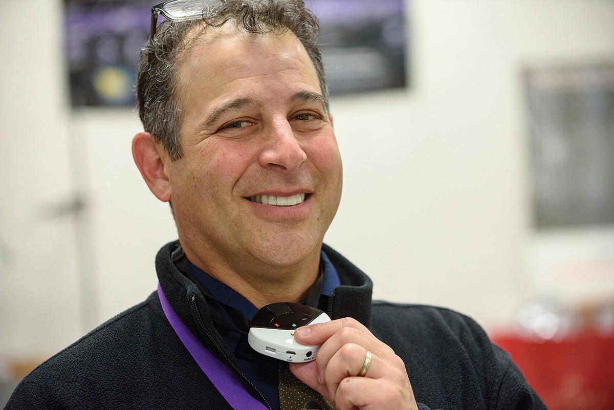 Teacher with Juno hands-free Microphone in a classroom